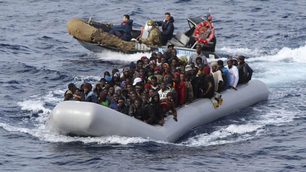 Migrants sit in a boat during a rescue operation by Italian navy off the coast of the south of the Italian island of Sicily in this November 28, 2013 picture provided by the Italian Marina Militare. About 350 migrants, who were travelling in four separate boats were rescued on Thursday in the operation called Mare Nostrum, Italian navy said. Picture taken November 28. REUTERS/Marina Militare/Handout via Reuters (ITALY - Tags: SOCIETY IMMIGRATION MARITIME TPX IMAGES OF THE DAY) ATTENTION EDITORS - THIS IMAGE WAS PROVIDED BY A THIRD PARTY. FOR EDITORIAL USE ONLY. NOT FOR SALE FOR MARKETING OR ADVERTISING CAMPAIGNS. THIS PICTURE IS DISTRIBUTED EXACTLY AS RECEIVED BY REUTERS, AS A SERVICE TO CLIENTS - RTX15XEX